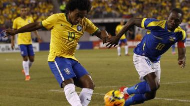 Willian #19 of Brazil fights for the ball with Walter Ayovi #10 of Ecuador during their match at MetLife Stadium on September 9, 2014 in East Rutherford, New Jersey. (Photo by Jeff Zelevansky/Getty Images)