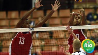 KATOWICE, POLAND - SEPTEMBER 1: Cuba player defends: Fiel David, Uriarte Osmany Santiago(right) during the FIVB World Championships match between Finland v Cuba on Septembert 1, 2014 in Katowice, Poland. (Photo by Adam Nocon/Getty Images for FIVB)