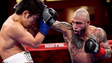 Miguel Cotto punches Yoshihiro Kamegai, as Cotto goes on to win in a 12 round unanimous decision during the WBO Junior Middleweight title fight at StubHub Center on August 26, 2017 in Carson, California. (Getty Images)