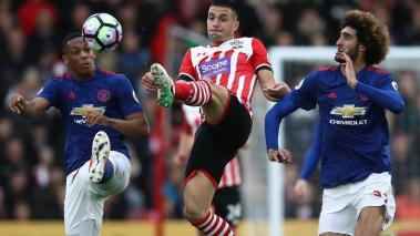 Anthony Martial and Marouane Fellaini of Manchester United attempt to win the ball from Dusan Tadic of Southampton at St Mary's Stadium on May 17, 2017 in Southampton, England. (Getty Images)