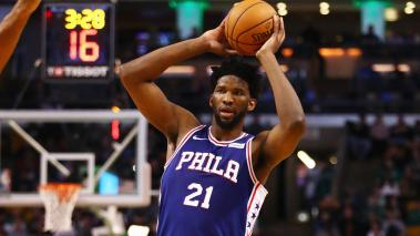Joel Embiid #21 of the Philadelphia 76ers handles the ball during the second half against the Boston Celtics at TD Garden on January 18, 2018 in Boston, Massachusetts. (Getty Images)
