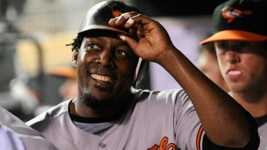 Vladimir Guerrero #27 of the Baltimore Orioles smiles in the dugout after scoring against the Minnesota Twins in the fifth inning on August 23, 2011 at Target Field in Minneapolis, Minnesota. (Photo by Hannah Foslien/Getty Images)