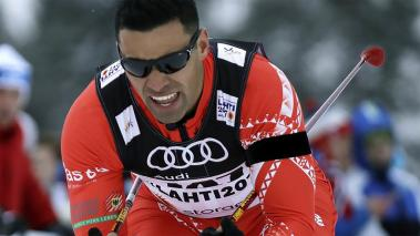 Tonga's Pita Taufatofua competes in the men's cross country sprint qualification at the 2017 Nordic Skiing World Championships in Lahti, Finland. (AP)