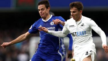 Cesar Azpilicueta of Chelsea (L) and Tom Carroll of Swansea City (R) during the Premier League match at Stamford Bridge on February 25, 2017 in London, England. (Getty Images)