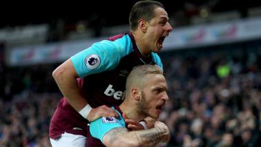 Marko Arnautovic of West Ham United celebrates with teammate Javier Hernandez after scoring his sides second goal during the Premier League match between West Ham United and Watford at London Stadium on February 10, 2018 in London, England. (Getty Images)