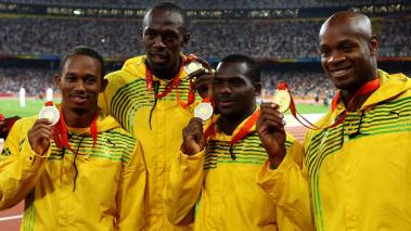 Michael Frater, Usain Bolt, Nesta Carter and Asafa Powell of Jamaica receive their gold medals for the Men's 4 x 100m Relay Finalheld at the National Stadium on Day 15 of the Beijing 2008 Olympic Games on August 23, 2008 in Beijing, China. (Getty Images)