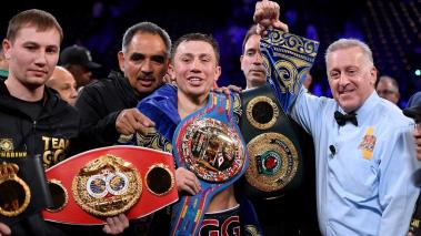Gennady Golovkin poses with his belts with referee Jack Reiss after a second round knockout win over Vanes Martirosyan at StubHub Center on May 5, 2018 in Carson, California. (Getty Images)