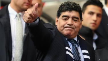 Diego Maradona waves to fans prior to the Premier League match between Tottenham Hotspur and Liverpool at Wembley Stadium on October 22, 2017 in London, England.  (Getty Images)