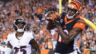 A.J. Green #18 of the Cincinnati Bengals scores a touchdown against Tavon Young #25 of the Baltimore Ravens during the first quarter at Paul Brown Stadium on September 13, 2018 in Cincinnati, Ohio. (Getty Images)