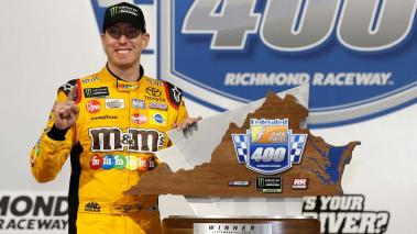 Kyle Busch, driver of the #18 M&M's Toyota, poses with the tropy in Victory Lane after winning the Monster Energy NASCAR Cup Series Federated Auto Parts 400 at Richmond Raceway on September 22, 2018 in Richmond, Virginia. (Getty Images)