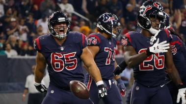 Greg Mancz #65 of Houston Texans spikes the ball after a touchdown run by Lamar Miller #26 against the Miami Dolphins at NRG Stadium on October 25, 2018 in Houston, Texas. (Getty Images)