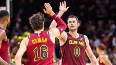 Cedi Osman #16 celebrates with Kevin Love #0 of the Cleveland Cavaliers after scoring at Quicken Loans Arena on October 21, 2018 in Cleveland, Ohio. Getty Images