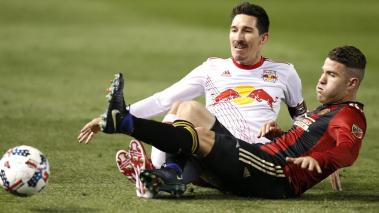 Sacha Kljestan #16 of the New York Red Bulls slides to battle for the ball with Greg Garza #4 of Atlanta United during the game at Bobby Dodd Stadium on March 5, 2017 in Atlanta, Georgia. (Getty Images)