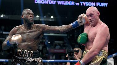 Deontay Wilder punches Tyson Fury in the ninth round fighting to a draw during the WBC Heavyweight Champioinship at Staples Center on December 1, 2018 in Los Angeles, California. (Getty Images)
