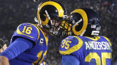 Los Angeles Rams running back C.J. Anderson (R) celebrates with quarterback Jared Goff (L) after scoring a touchdown at the LA Memorial Coliseum in Los Angeles, California, USA, 12 January 2019. EFE