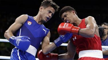 Cuba's Robeisy Ramirez, left, and United States' Shakur Stevenson exchange punches during a men's bantamweight 56-kg final boxing match at the 2016 Summer Olympics in Rio de Janeiro, Brazil, Saturday, Aug. 20, 2016. (AP)