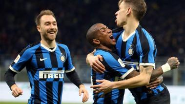 Inter's Nicolo Barella (R) jubilates with teammates Ashley Young (R) and Christian Eriksen (L) after scoring the 2-1 goal during the Italian Cup quarter finals soccer match between FC Inter and ACF Fiorentina at the Giuseppe Meazza stadium in Milan. EFE