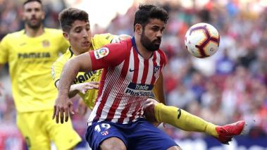 Diego Costa of Atletico Madrid shields the ball from Santiago Cáseres of Villarreal during the La Liga match between Club Atletico de Madrid and Villarreal CF at Wanda Metropolitano on February 24, 2019 in Madrid, Spain. (Getty Images)