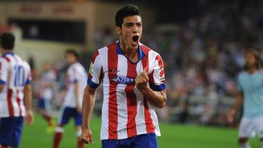 Raul Jimenez of Club Atletico de Madrid celebrates after beating Sergio Alvarez of Real Club Celta de Vigo to put the ball in the net during the La Liga match at the Vicente Calderon stadium on September 20, 2014 in Madrid, Spain. (Getty Images)