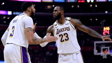 LeBron James #23 and Anthony Davis #3 of the Los Angeles Lakers celebrate a basket during a 112-103 win over the LA Clippers at Staples Center on March 08, 2020 in Los Angeles, California. (/Getty Images)