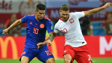 Colombia's midfielder James Rodriguez (L) vies with Poland's defender Lukasz Piszczek during the Russia 2018 World Cup Group H football match between Poland and Colombia at the Kazan Arena in Kazan on June 24, 2018. Getty Images