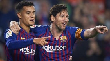 Lionel Messi (L) and Philippe Coutinho (R) of Barcelona celebrates the second goal during the La Liga match between FC Barcelona and Sevilla FC at Camp Nou on October 20, 2018 in Barcelona, Spain. (Getty Images)