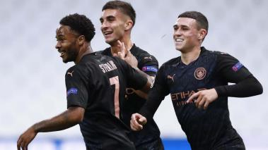 Manchester City's Ferran Torres (C) celebrates with Raheem Sterling (L) and Phil Foden (R) during the UEFA Champions League Group C soccer match against Marseille at the Orange Velodrome stadium, in Marseille, France 27 October 2020. EFE
