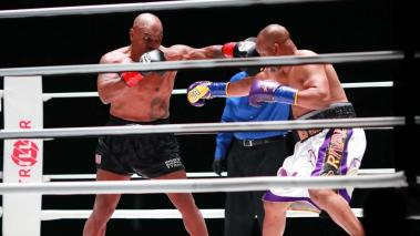 Mike Tyson throws a punch in the third round against Roy Jones Jr. during Mike Tyson vs Roy Jones Jr. presented by Triller at Staples Center on November 28, 2020 in Los Angeles, California. (Getty Images)
