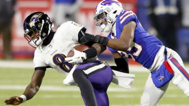 Levi Wallace #39 of the Buffalo Bills sacks Lamar Jackson #8 of the Baltimore Ravens in the first quarter during the AFC Divisional Playoff game at Bills Stadium on January 16, 2021 in Orchard Park, New York. (Getty Images)