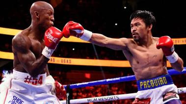 Manny Pacquiao (R) of the Philippines fights against Yordenis Ugas of Cuba during the WBA Welterweight Championship boxing match at T-Mobile Arena in Las Vegas, Nevada on August 21, 2021. (Getty Images)