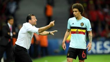 LILLE, FRANCE - JULY 01: Marc Wilmots (L) manager of Belgium instructs Axel Witsel (R) during the UEFA EURO 2016 quarter final match between Wales and Belgium at Stade Pierre-Mauroy on July 1, 2016 in Lille, France. (Photo by Matthias Hangst/Getty Images)