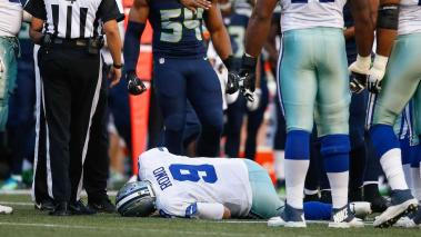 Quarterback Tony Romo #9 of the Dallas Cowboys lies on the turf after being injured in the first quarter during a preseason game against the Seattle Seahawks at CenturyLink Field on August 25, 2016 in Seattle, Washington. (Getty Images)
