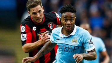 Raheem Sterling of Manchester City gets past Dan Gosling of Bournemouth as they compete for the ball during the Barclays Premier League at Etihad Stadium on October 17, 2015 in Manchester, England. (Photo by Dean Mouhtaropoulos/Getty Images)