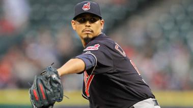 Carlos Carrasco #59 of the Cleveland Indians pitches. (Photo by Bob Levey/Getty Images)