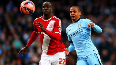 Albert Adomah of Middlesbrough chases an underhit backpass from Fernando of Manchester City during the FA Cup Fourth Round match between Manchester City and Middlesbrough at Etihad Stadium on January 24, 2015 in Manchester, England. (Photo Getty Images)