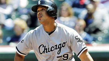 Chicago White Sox's Jose Abreu watching his solo home run off Cleveland Indians starting pitcher Corey Kluber in the first inning of a baseball game in Cleveland. (AP Photo/Mark Duncan, File)