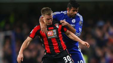 Diego Costa (C) of Chelsea fouls Matt Ritchie (L) of Bournemouth resulting in an yellow card during the Barclays Premier League match between Chelsea and A.F.C. Bournemouth at Stamford Bridge on December 5, 2015 in London, England. (Getty Images)