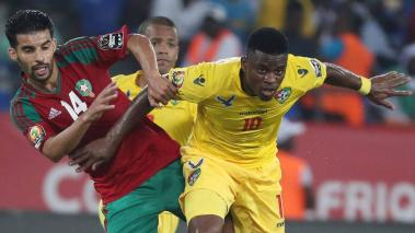 Floyd Ayite (R) of Togo tackled by Mbark Boussoufa of Morocco during the 2017 Africa Cup of Nations Finals at the Oyem Stadium in Oyem, Gabon, 20 January 2017. EFE