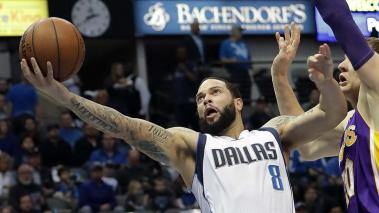 Deron Williams #8 of the Dallas Mavericks takes a shot against Timofey Mozgov #20 of the Los Angeles Lakers at American Airlines Center on January 22, 2017 in Dallas, Texas. Getty Images