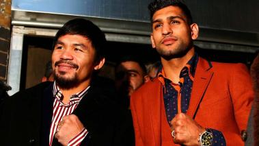 Manny Pacquiao and Amir Khan pose after holding discussions about the possibility of a future fight, at Fitzroy Lodge Amateur Boxing Club on January 23, 2015 in London, England. (Photo by Dan Istitene/Getty Images)