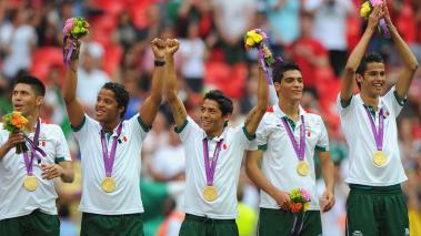 Gold medallists Mexico celebrate during the medal ceremony for the Men's Football Final between Brazil and Mexico on Day 15 of the London 2012 Olympic Games at Wembley Stadium on August 11, 2012 in London, England. (Getty Images)
