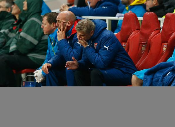 Arsene Wenger, manager of Arsenal reacts on the bench as a 3-0 lead is lost during the UEFA Champions League Group D match between Arsenal FC and RSC Anderlecht at Emirates Stadium on November 4, 2014 in London, United Kingdom