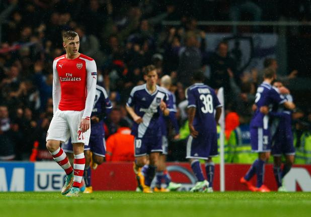 Despair for Calum Chambers of Arsenal (21) as Aleksandar Mitrovic of Anderlecht (not pictured) scores their third goal during the UEFA Champions League Group D match between Arsenal FC and RSC Anderlecht at Emirates St. on November 4, 2014 in London. Getty Images