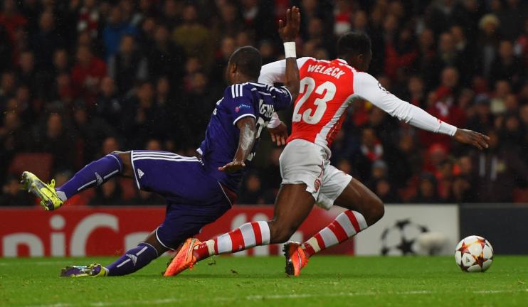 Danny Welbeck of Arsenal is fouled by Chancel Mbemba of Anderlecht for a penalty during the UEFA Champions League Group D match between Arsenal FC and RSC Anderlecht at Emirates Stadium on November 4, 2014 in London, United Kingdom. (Photo by Michael Regan/Getty I