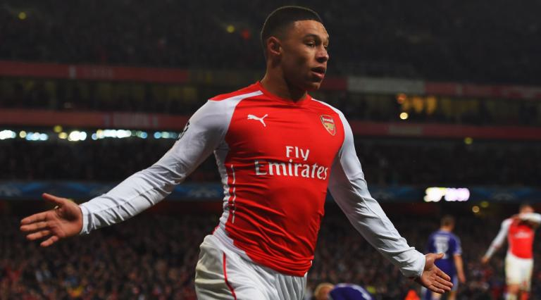 Alex Oxlade-Chamberlain of Arsenal celebrates as he scores their third goal during the UEFA Champions League Group D match between Arsenal FC and RSC Anderlecht at Emirates Stadium on November 4, 2014 in London, United Kingdom. (Photo by Michael Regan/Getty Images