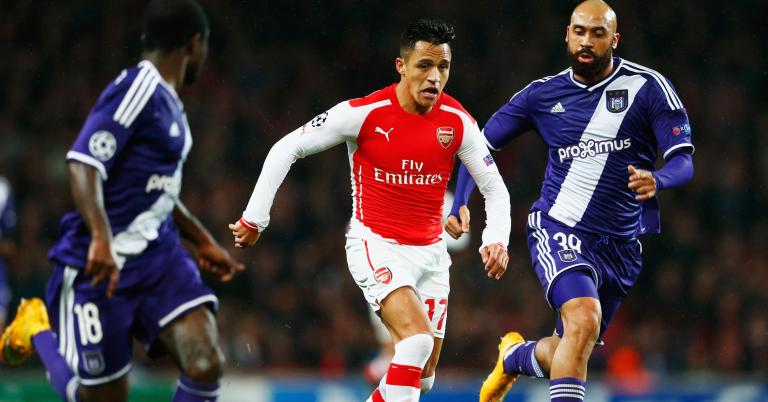 Alexis Sanchez of Arsenal (C) takes on Frank Acheampong (L) and Anthony Vanden Borre of Anderlecht (R) during the UEFA Champions League Group D match between Arsenal FC and RSC Anderlecht at Emirates Stadium on November 4, 2014 in London, United Kingdom. (Getty)