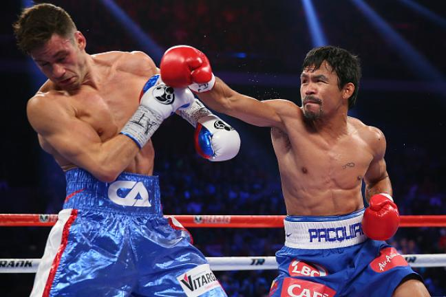 Manny Pacquiao of the Philippines and Chris Algieri of the United States exchange punches during the WBO world welterweight title at The Venetian on November 23, 2014 in Macau, Macau. (Photo by Chris Hyde/Getty Images)