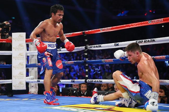 Manny Pacquiao of the Philippines knockes down Chris Algieri of the United States during the world welterweight title at The Venetian on November 23, 2014 in Macau, Macau. (Photo by Chris Hyde/Getty Images)
