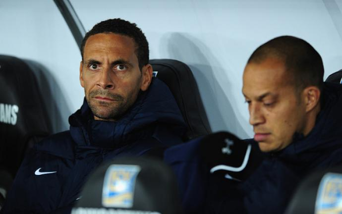 QPR player Rio Ferdinand looks on from the bench before the Barclays Premier League match between Swansea City and Queens Park Rangers at Liberty Stadium on December 2, 2014 in Swansea, Wales. (Getty Images)