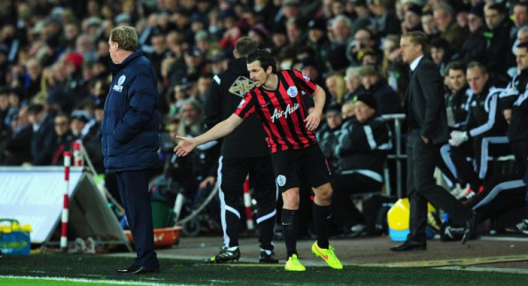 QPR player Joey Barton attempts to shake hands with manager Harry Redknapp during the Barclays Premier League match between Swansea City and Queens Park Rangers at Liberty Stadium on December 2, 2014 in Swansea, Wales. (Getty Images)